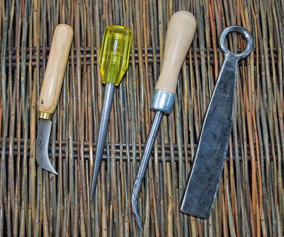 knife, awl, curved awl, rapping iron