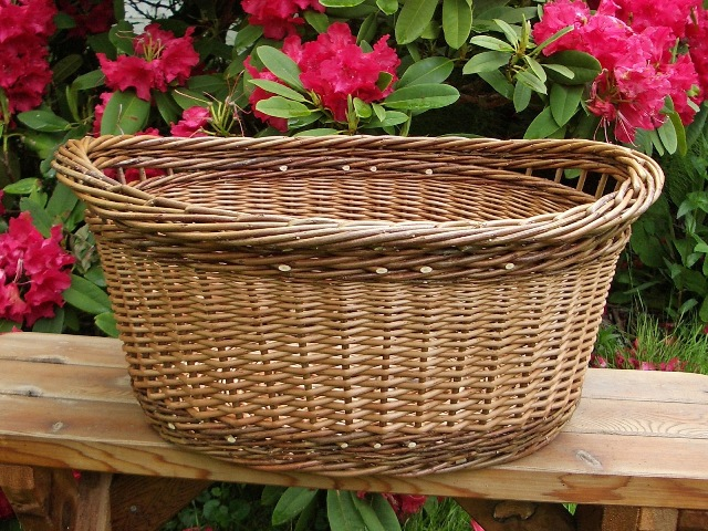 oval willow laundry basket with inset handles
