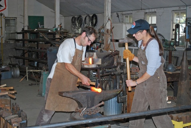 Adair Orr and Missy Holland blacksmithing
