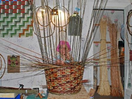 Katherine weaving her basket.