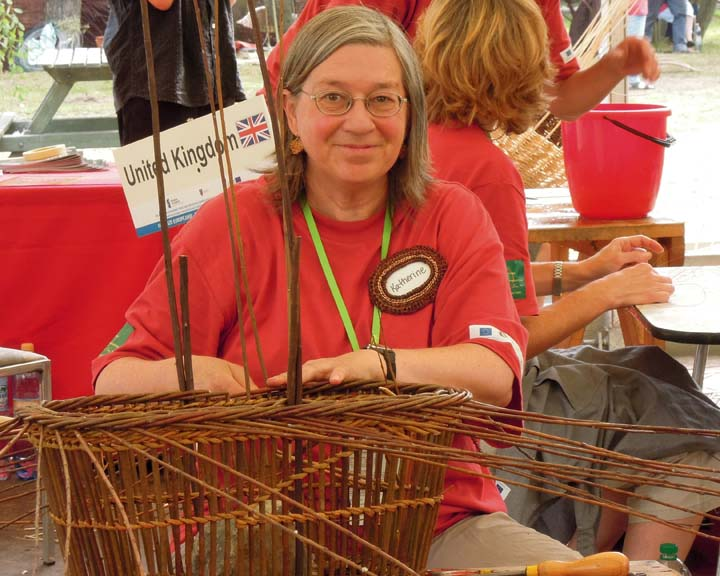 Katherine Lewis weaving willow basket at Poland's wicker festival